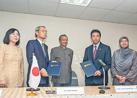 The signing of an MOU between IOP and CCDUM